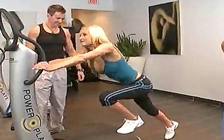 gorgeous busty blond working out at the gym