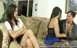 mother showing dilettante daughter how to give