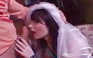 brunette hair hottie with bride veil gives