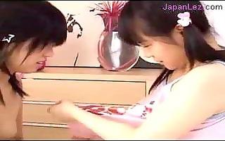 2 youthful gals engulfing teats licking fingering