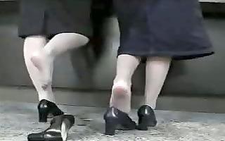 candid shoeplay - 2 hostess dipping heels