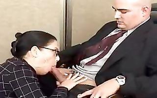 darksome haired reina leone engulfing her boss