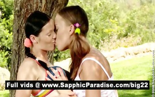 angelic brunette and redhead lesbos giving a kiss