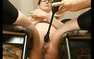 shaved mature with a wand