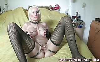 pierced granny with chains to her pierced snatch