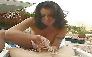 freaky chick wearing a bikini gives an outdoor