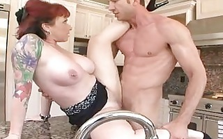 heavy chested redhead with pierced teats receives