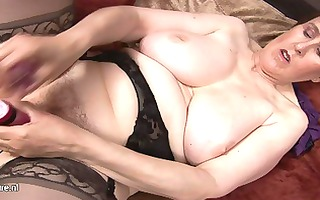 horny mature grandmother playing with her old