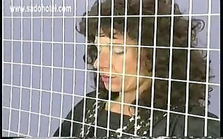 naughty girl in a jail got her large metal clamps