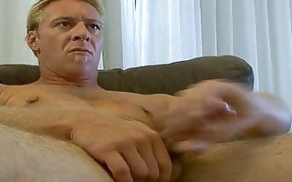 gay hunk jerks off on couch